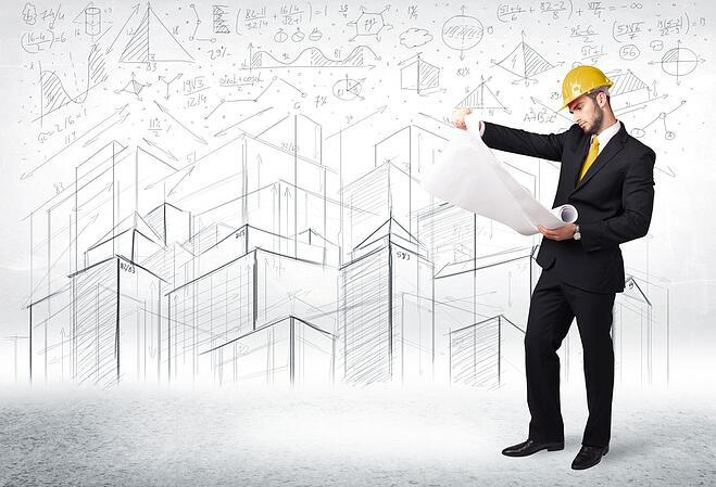 Handsome construction specialist with city drawing in background concept-1.jpeg