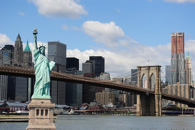 The landmark Statue of Liberty against the impressive New York City skyline..jpeg